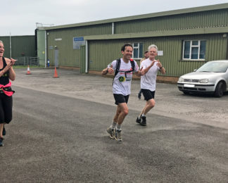 Pilot powers through 50 mile cross-country run for Air Ambulance charities