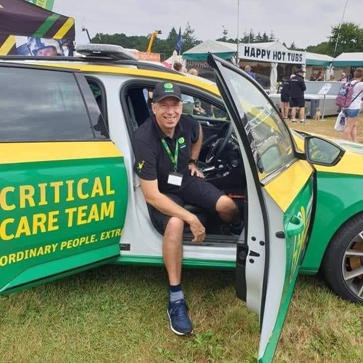 Mike Bainbridge sat in a Critical Care Team Vehicle with the door open.