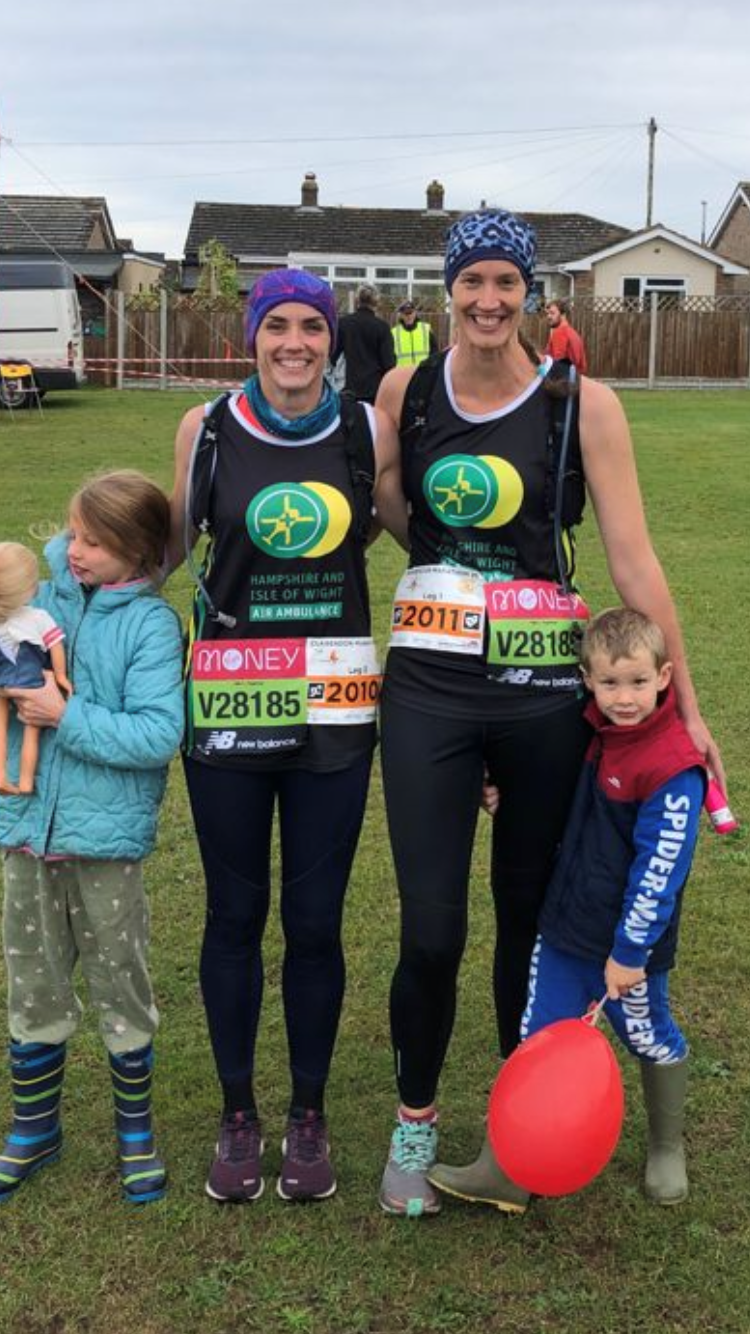Clare and Kat pictured in their running gear with two young children either side of them